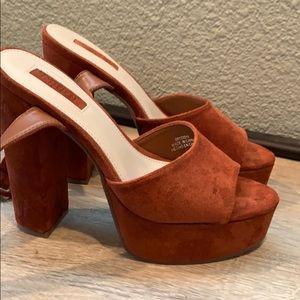 Brown strap platforms